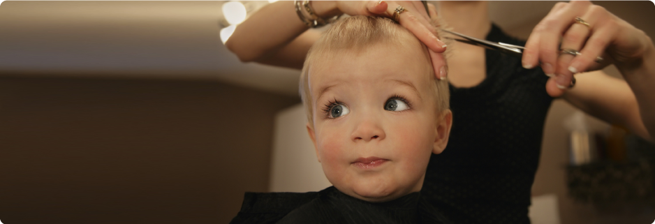 Young child getting a hair cut