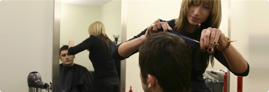 Stylist cutting man's hair