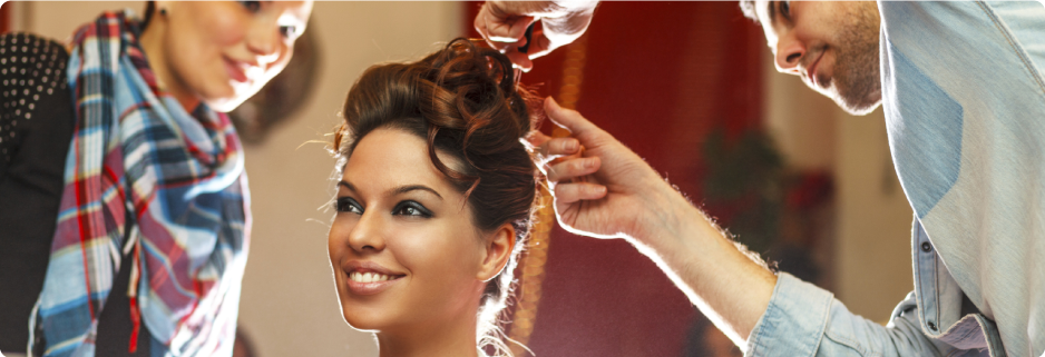 Young woman geting a fancy up-do